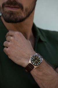 Man wearing a retro watch in brown