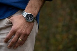 Man's wrist with citizen corso watch